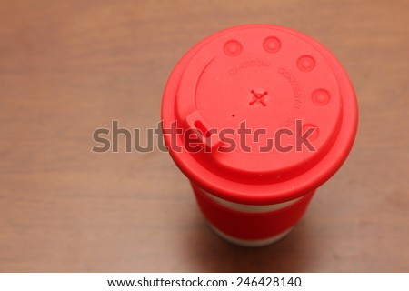 cup of hot coffee on the wooden table - stock photo
