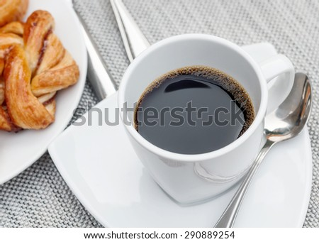 Cup of hot coffee with bake for breakfast - stock photo