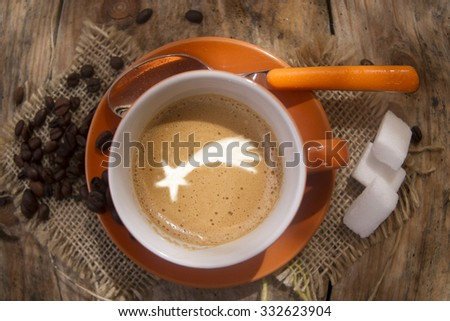 Cup of hot coffee with drawn party items Christmas - stock photo