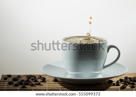 Cup of hot coffee with droplet