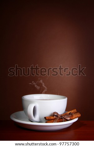 Cup of Hot Coffee with on a wooden table - stock photo
