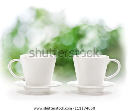 Cup of hot drink on summer background - stock photo