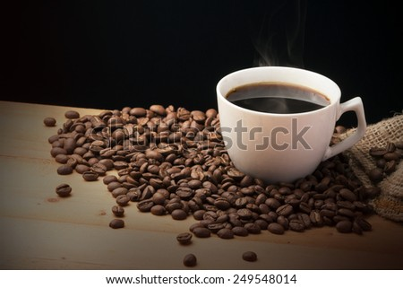 Cup of hot drink with coffee - stock photo