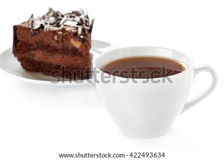 Cup of hot tea and homemade cake on white background