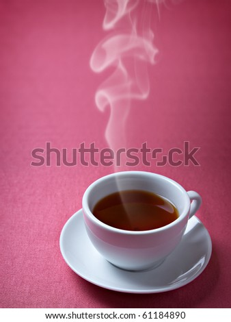 Cup of hot tea on the pink background - stock photo