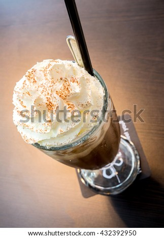 Cup of iced mocha coffee with whipping cream - stock photo