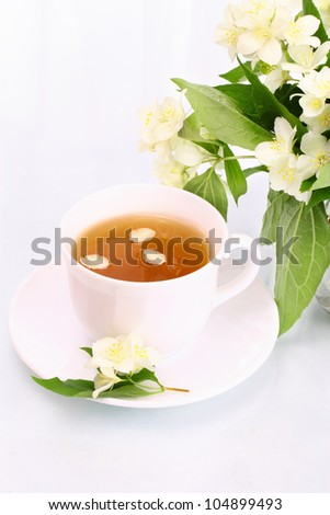 Cup of jasmine tea and flowers