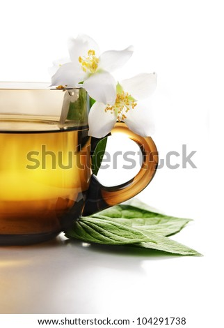 Cup of jasmine tea with white background - stock photo