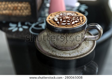 Cup of latte coffee, Cappuccino or latte coffee cup with art foam - stock photo