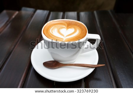 Cup of latte coffee on wood background - stock photo