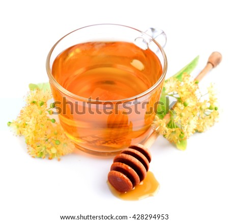 Cup of linden tea with flowers and honey isolated on white