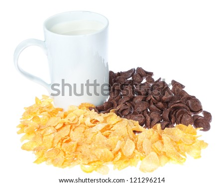Cup of milk on a background chocolate corn flakes. - stock photo