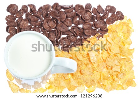 Cup of milk on a background corn flakes and chocolate flakes. - stock photo