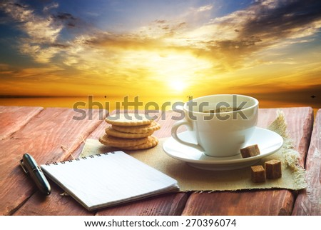 Cup of morning coffee on a wooden table - stock photo