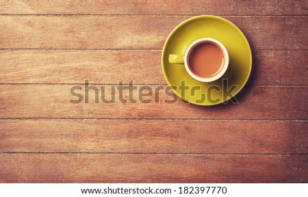 Cup of ?offee on a wooden table. - stock photo