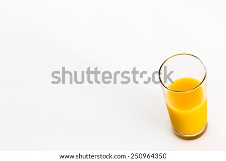 Cup of orange juice isolated on white background.  - stock photo