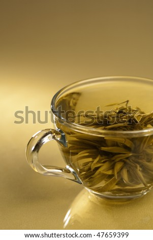 Cup of pure green tea on the abstract reflected background