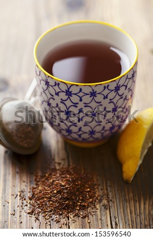 cup of red tea (rooibos) - stock photo
