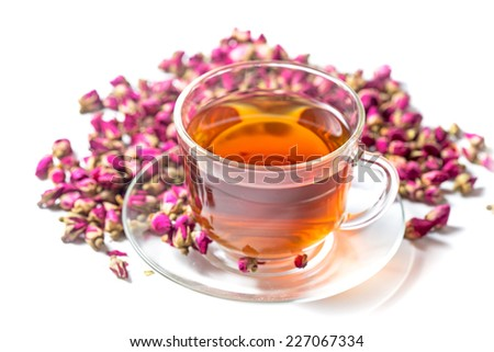 Cup of roses tea with rose buds on white baackground - stock photo