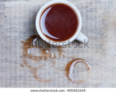 cup of spilled coffee on a wooden surface.toned.view from above  - stock photo