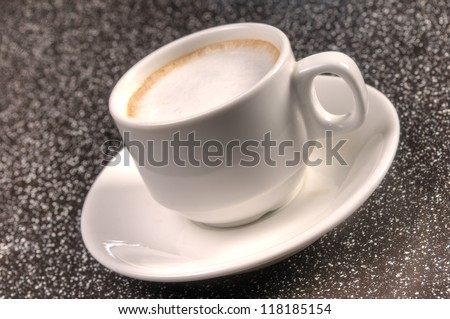 Cup of steaming hot coffee over dark background - stock photo
