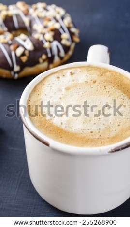 Cup of strong black espresso coffee and two tempting fresh doughnuts  - stock photo