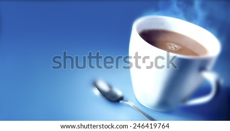 CUP OF TEA - A blurred shot of a hot cup of tea against a blue background - stock photo
