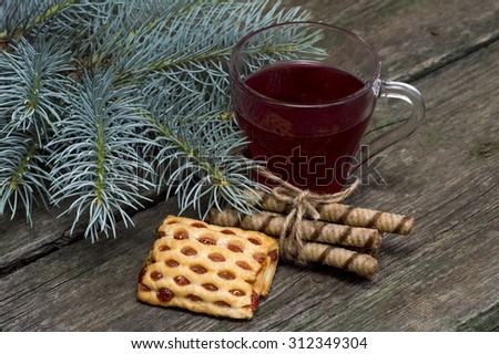 cup of tea a fir-tree branch and cookies - stock photo