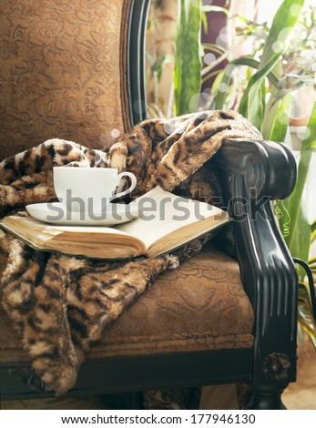 Cup of tea and book - stock photo