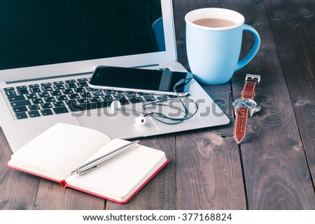 cup of tea and casual business outfits on wood board background