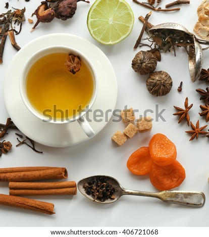 Cup of tea and delicious ingredients on table