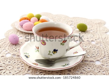 cup of tea and easter eggs on beautiful napkin