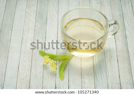 cup of tea and linden blossoms, bright wooden