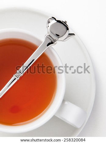 Cup of Tea and Silver Spoon - stock photo