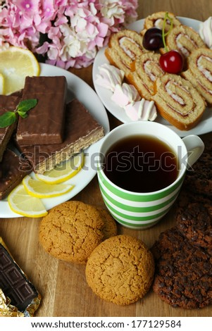 Cup of tea and sweets close up