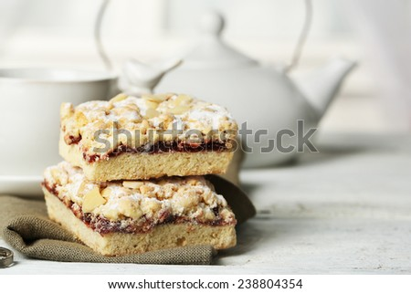 Cup of tea and tasty homemade pie on wooden table - stock photo