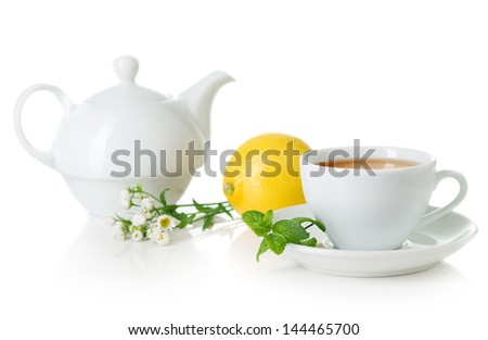 Cup of tea and teapot - stock photo