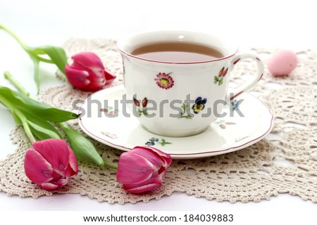 cup of tea and tulips on beautiful napkin
