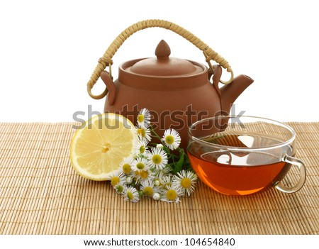 cup of tea, chamomile, lemon  and clay teapot