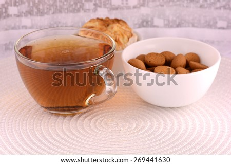 cup of tea (coffee) and some cookies on white plate - stock photo