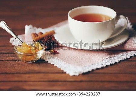Cup of tea, honey and spices on table closeup