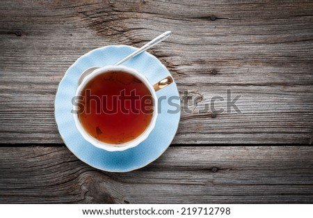 Cup of tea on a wooden background  top view - stock photo