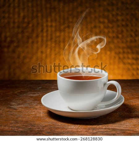 cup of tea on a wooden table - stock photo
