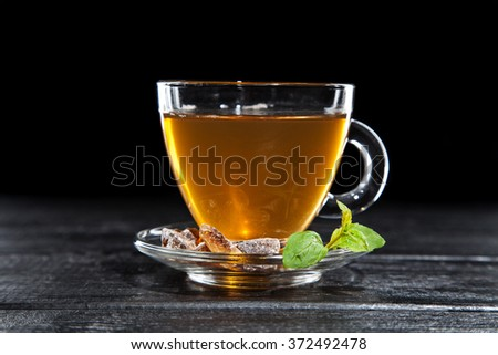 Cup of tea on dark background - stock photo