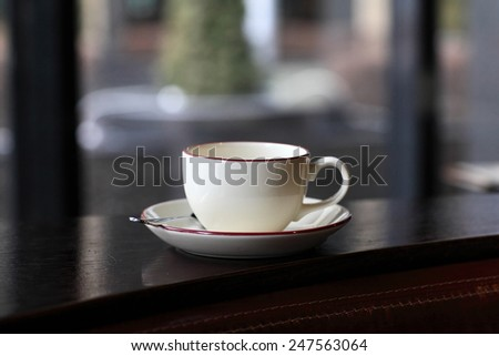 Cup of tea on the window background - stock photo
