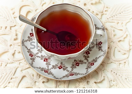 Cup of tea on white tablecloth - stock photo