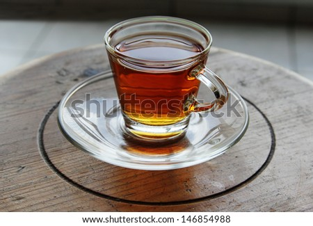 cup of tea standing on small wooden table