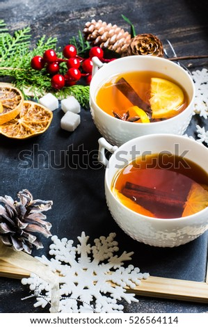 Cup of Tea with a Lemon and Cinnamon on Christmas Background. Rustic style