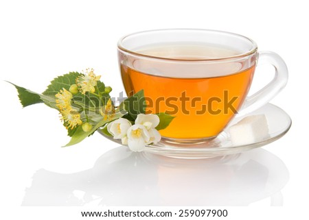 Cup of tea with a saucer and the jasmine and linden flower, isolated on white - stock photo