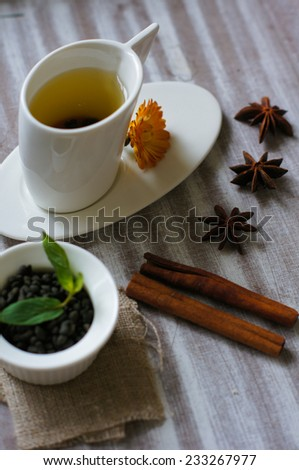 Cup of tea with cinnamon and anise star on the wooden table